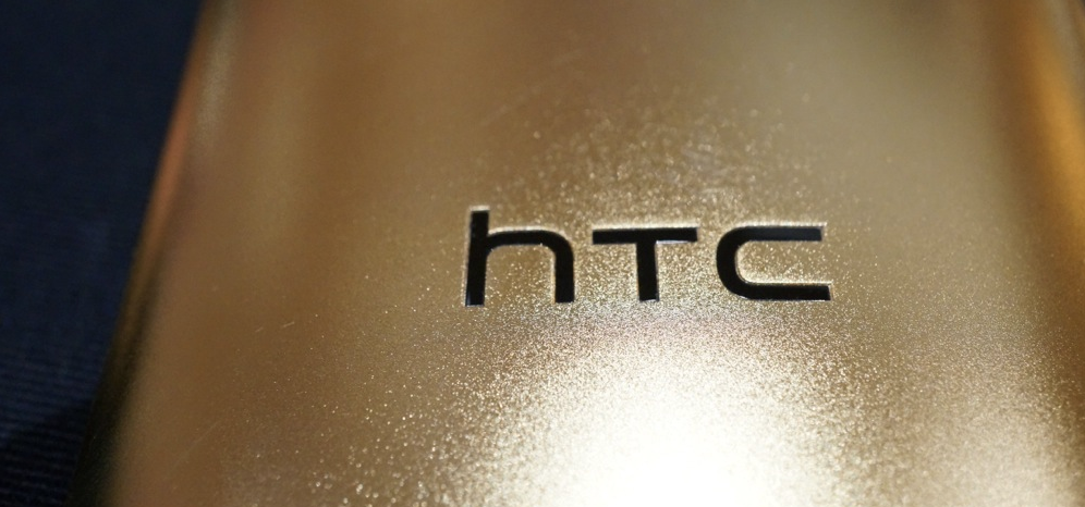 htc logo gold 18k